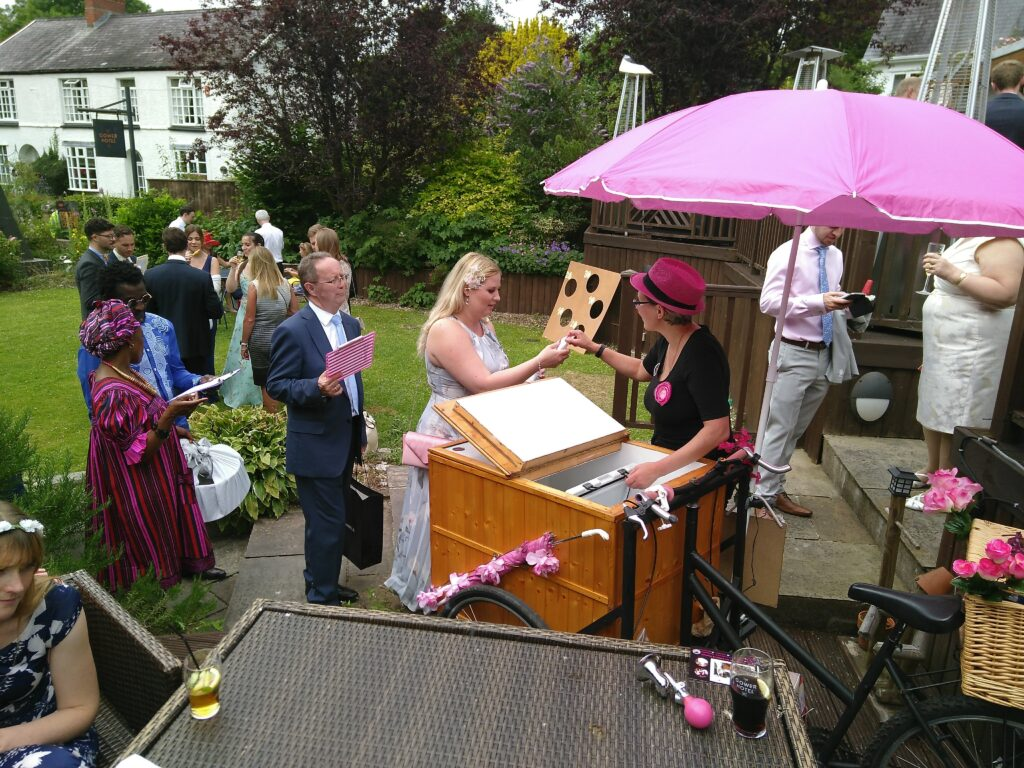 Pop Cycle serving poptails from the tricycle at a wedding at the Gower Hotel