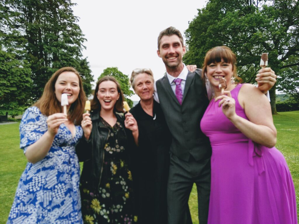 Wedding guests enjoying Pop Cycle poptails at Llansteffan mansion house